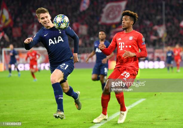 Juan Foyth of Tottenham Hotspur challenges for the ball with Kingsley Coman of FC Bayern Munich during the UEFA Champions League group B match...