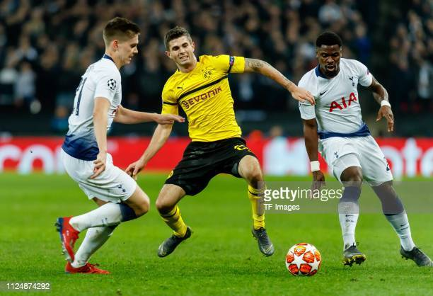 Juan Foyth of Tottenham Hotspur Christian Pulisic of Dortmund and Serge Aurier of Tottenham Hotspur battle for the ball during the UEFA Champions...