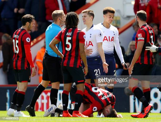 Juan Foyth of Tottenham Hotspur confronts referee Craig Pawson after Juan Foyth fouls Jack Simpson of AFC Bournemouth before Craig Pawson then awards...