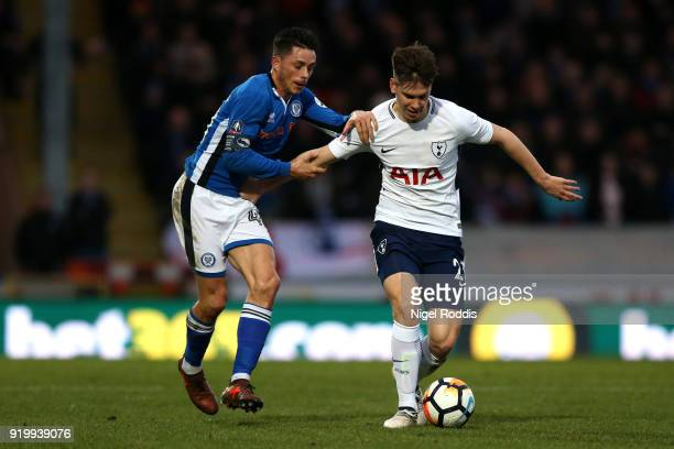 Juan Foyth of Tottenham Hotspur is challenged by Ian Henderson of Rochdale AFC during The Emirates FA Cup Fifth Round match between Rochdale and...