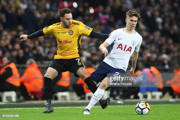 Juan Foyth of Tottenham Hotspur is challenged by Robbie Willmott of Newport County during the Fly Emirates FA Cup Fourth Round Replay match between...