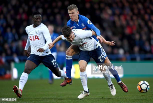 Juan Foyth of Tottenham Hotspur is tackled by Mark Kitching of Rochdale AFC during The Emirates FA Cup Fifth Round match between Rochdale and...