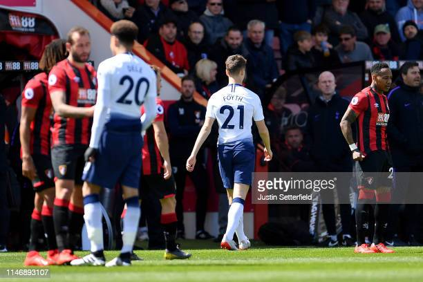 Juan Foyth of Tottenham Hotspur leaves the pitch after receiving a red card during the Premier League match between AFC Bournemouth and Tottenham...