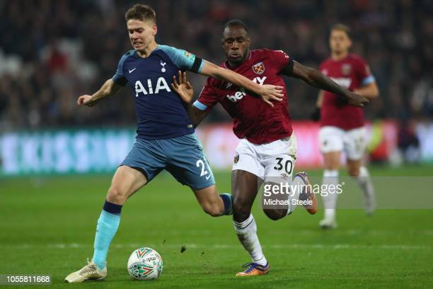 Juan Foyth of Tottenham is challenged by Michail Antonio of West Ham during the Carabao Cup Fourth Round match between West Ham United and Tottenham...