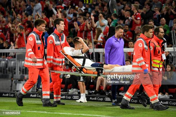 Juan Foyth of Tottenham leaves the pitch due to injury during the Audi cup 2019 final match between Tottenham Hotspur and Bayern Muenchen at Allianz...