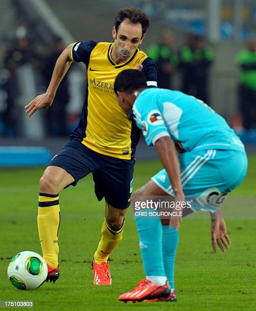 Juan Fran of Spain´s Atletico Madrid and Nelinho Quina of Peru's Sporting Cristal vie for the ball during their Euroamerican Cup football match at...
