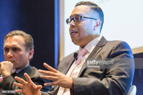 Juan Francisco Caudillo technical analyst at Holding Monex SAB right speaks as Carlos Kretschmer director general of Quanta Shares looks on during...