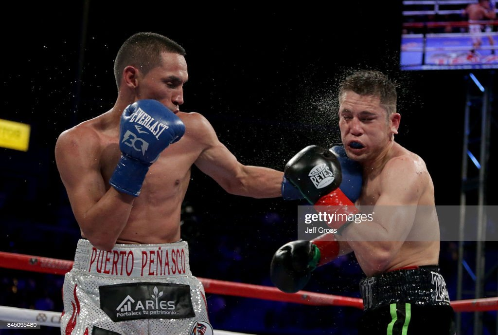 Juan Francisco Estrada of Mexico lands a left hand to the chin of Carlos Cuadras of Mexico at StubHub Center on September 9, 2017 in Carson, California.