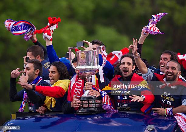 Juan Francisco 'Juanfran' Adra Turan and Radamel Falcao of Atletico de Madrid celebrate from an opentop bus a day after winning the Copa del Rey...