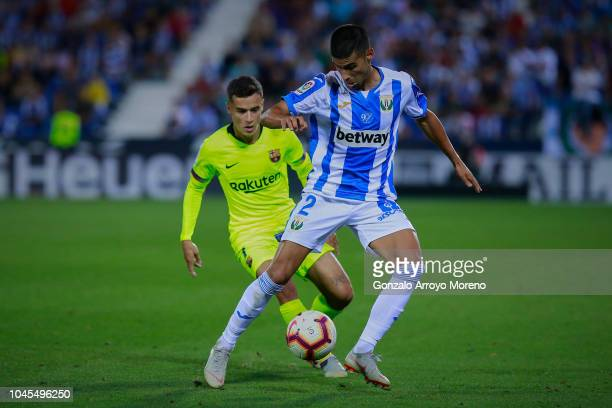 Juan Francisco Moreno Fuertes of Deportivo Leganes competes for the ball with Philippe Coutinho of FC Barcelona during the La Liga match between CD...