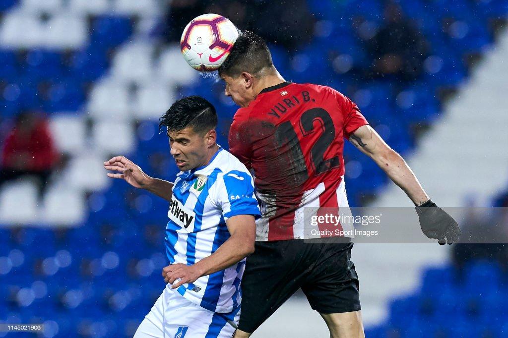 Juan Francisco Moreno of CD Leganes battle for the ball with Yuri ...