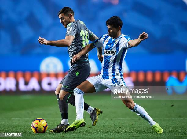 Juan Francisco Moreno of CD Leganes duels for the ball with Theo Hernandez of Real Sociedad during the La Liga match between Real Sociedad and CD...