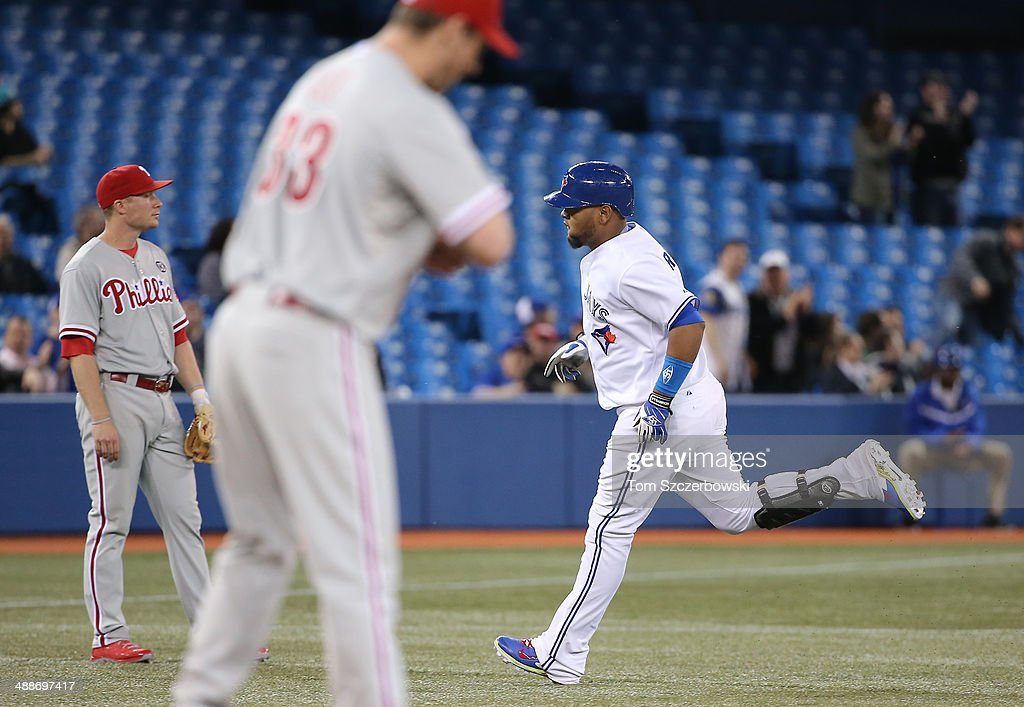 Juan Francisco #47 of the Toronto Blue Jays circles the bases after hitting a two-run home run in the seventh inning during MLB game action as Cliff Lee #33 of the Philadelphia Phillies gets a new baseball on May 7, 2014 at Rogers Centre in Toronto, Ontario, Canada.