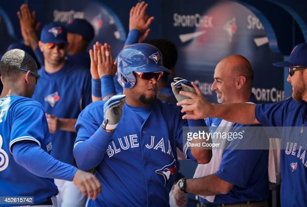 Juan Francisco of the Toronto Blue Jays gets props fro his team mates after he hit a two run homer in the bottom of the third to make it 5-0 as the...