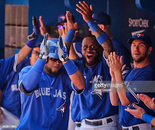TORONTO ON JULY 24 Juan Francisco of the Toronto Blue Jays gets props fro his team mates after he hit a two run homer in the bottom of the third to...