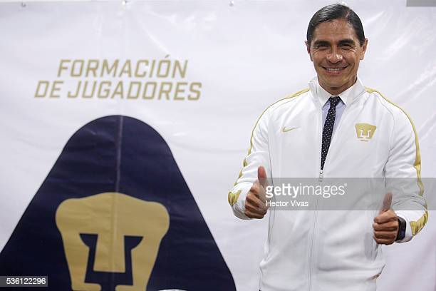 Juan Francisco Palencia coach of Pumas UNAM smiles during a Press Conference to unveil Juan Francisco Palencia as new coach of Pumas UNAM at Olimpico...