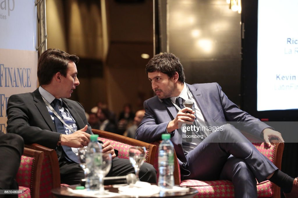 Juan Francisco Toro, director of Astris Finance LLC, left, speaks with Federico Bazan, chiefe executive officer of the Nuevo Banco de la Rioja SA, during the Argentina Sub-Sovereign and Infrastructure Finance Summit in Buenos Aires, Argentina, on Wednesday, Nov. 29, 2017. The event will join Argentina's provincial and municipal leaders together with regional and international investors, infrastructure developers, financiers and advisers to discuss sub-sovereign financial and investment strategies and explore what needs to be done to efficiently put capital to work in new infrastructure projects. Photographer: Sarah Pabst/Bloomberg via Getty Images