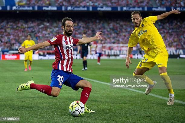 Juan Francisco Torres alias Juanfran of Atletico de Madrid competes for the ball with Daniel Castello of UD Las Palmas during the La Liga match...