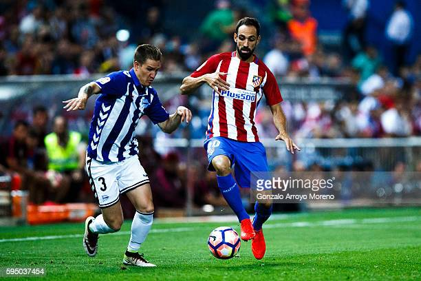 Juan Francisco Torres alias Juanfran of Atletico de Madrid competes for the ball with Raul Garcia of Deportivo Alaves during the La Liga match...