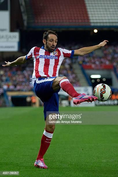 Juan Francisco Torres alias Juanfran of Atletico de Madrid strikes the ball during the La Liga match between Club Atletico de Madrid and SD Eibar at...