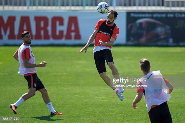 Juan Francisco Torres alias Juanfran saves on a header during the training session during the Club Atletico de Madrid Open Media Day ahead of the...