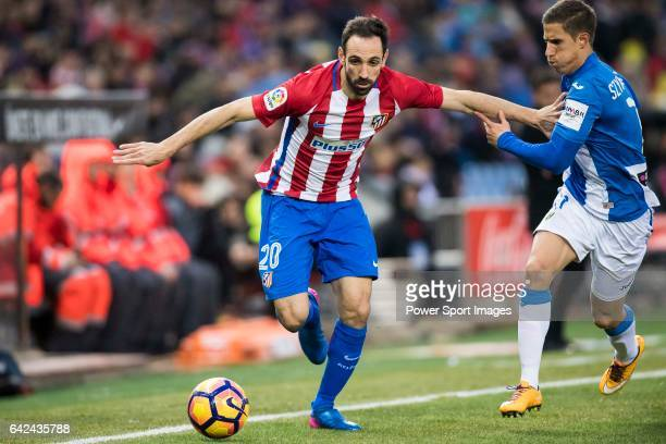Juan Francisco Torres Belen Juanfran of Atletico de Madrid competes for the ball with Alexander Szymanowski of Deportivo Leganes during their La Liga...