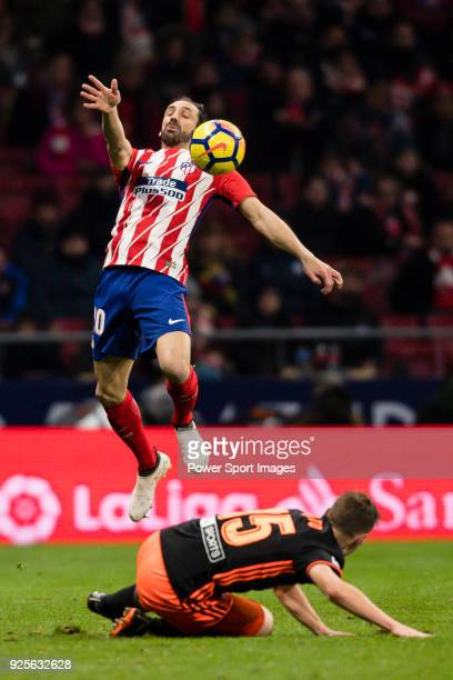 Juan Francisco Torres Belen Juanfran of Atletico de Madrid fights for the ball with Antonio Latorre Grueso Lato of Valencia CF during the La Liga...