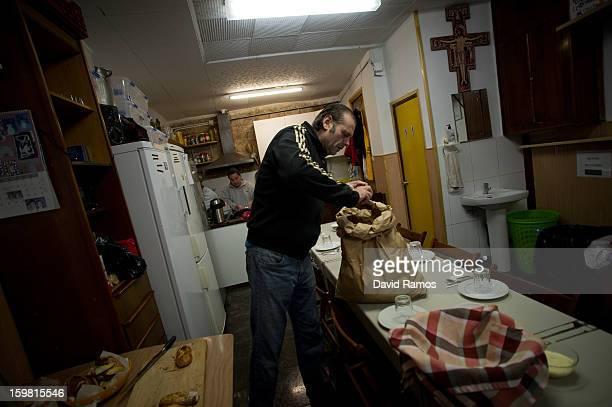 Juan from Spain prepares the breakfast for needy people before opening 'El Chiringuito de Dios' in english on January 3 2013 in Barcelona Spain Juan...