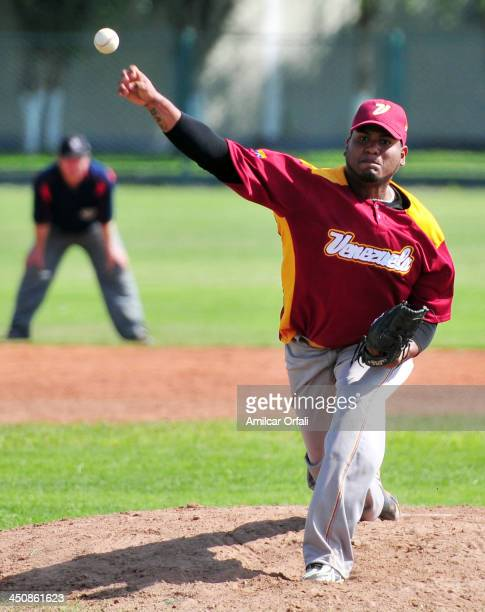 Juan Fuentes of Venezuela throws the ball during the baseball qualifiers match vs Ecuador as part of the XVII Bolivarian Games Trujillo 2013 at Villa...