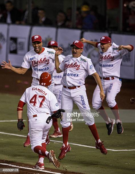 Juan Gamboa celebrates after making a home run to win the championship between Pericos de Puebla and Diablos Rojos as part of Serie del Rey Mexican...