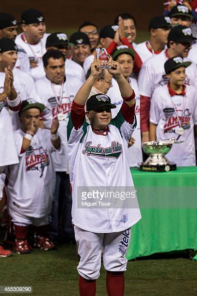 Juan Gamboa holds up the MVP trophy after a match between Pericos de Puebla and Diablos Rojos as part of Serie del Rey Mexican Baseball League at...