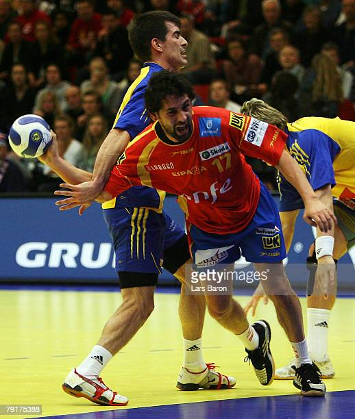 Juan Garcia of Spain in action with Dalibor Doder of Sweden during the Men's Handball European Championship main round Group II match between Spain...