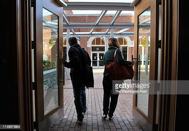 Juan Gomez L a senior at Georgetown University makes his way across campus with fellow student Kathleen Mulvaney R on campus on March 26 in...