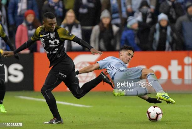 TOPSHOT Juan Gonzalez of Independiente vies for the ball with Felipe Gutierrez of Sporting KC during the CONCACAF Champions League quarterfinal...