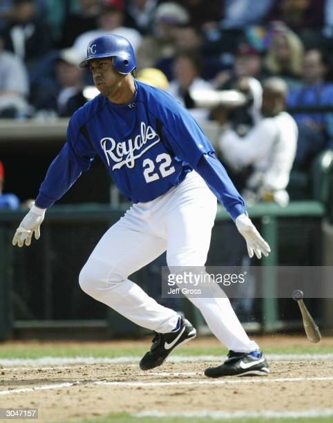 Juan Gonzalez of the Kansas City Royals drops his bat after hitting a single during a spring training game against the Texas Rangers on March 5 2004...