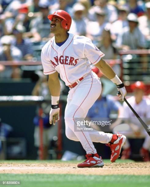 Juan Gonzalez of the Texas Rangers bats during an MLB game at The Ballpark in Arlington in Arlington Texas during the 1995 season