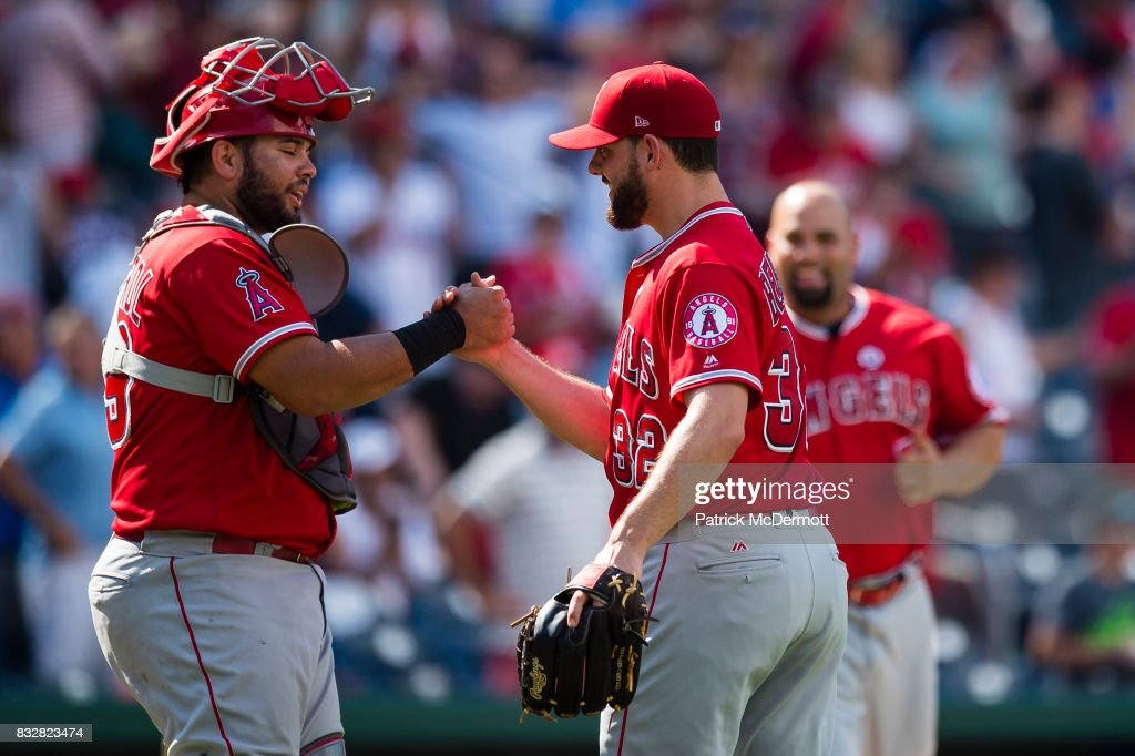 Juan Graterol #59 and Cam Bedrosian #32 of the Los Angeles Angels of Anaheim celebrate after defeating the Washington Nationals 3-2 at Nationals Park on August 16, 2017 in Washington, DC.