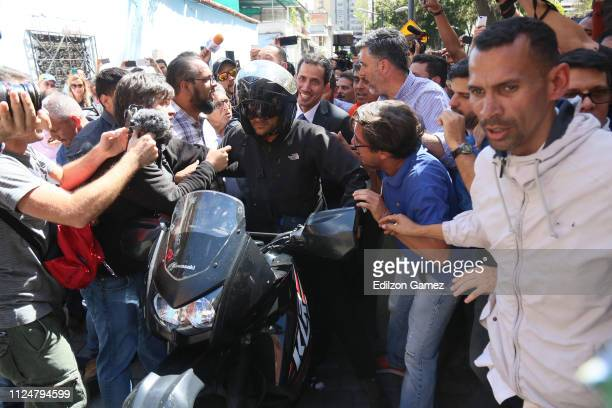 Juan Guaidó, who has appointed himself interim president, arrives to a meeting with deputies, media and supporters organized by the National Assembly...