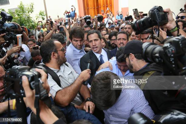 Juan Guaidó, who has appointed himself interim president leaves a meeting with deputies, media and supporters organized by the National Assembly at...