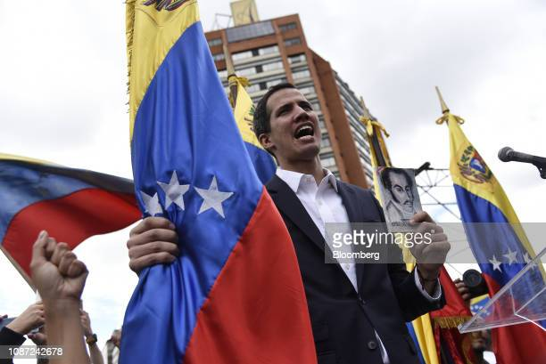 Juan Guaido president of the National Assembly sings the national anthem during a proopposition rally in Caracas Venezuela on Wednesday Jan 23 2019...