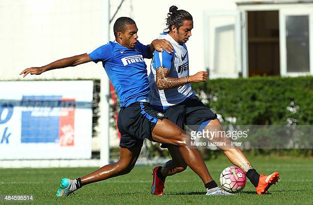 Juan Guilherme Nunes Jesus competes with Ezequiel Schelotto during FC Internazionale training session at the club's training ground on August 20 2015...