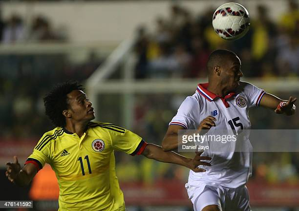Juan Guillermo Cuadrado of Colombia and Junior Diaz of Costa Rica go for a header during a friendly match between Colombia and Costa Rica at Diego...