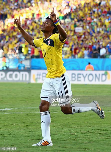 Juan Guillermo Cuadrado of Colombia celebrates scoring his team's first goal after a penalty kick during the 2014 FIFA World Cup Brazil Group C match...