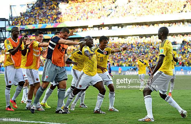 Juan Guillermo Cuadrado of Colombia celebrates scoring his team's first goal with his teammates during the 2014 FIFA World Cup Brazil Group C match...