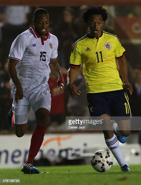 Juan Guillermo Cuadrado of Colombia is chased by Junior Diaz of Costa Rica during a friendly match between Colombia and Costa Rica at Diego Armando...