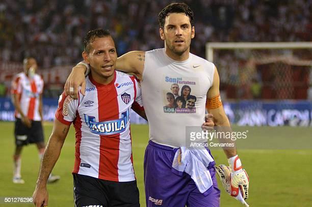 Juan Guillermo Dominguez and Sebastián Viera of Junior hug after a first leg match between Deportes Tolima and Ateltico Junior as part of Semi Finals...
