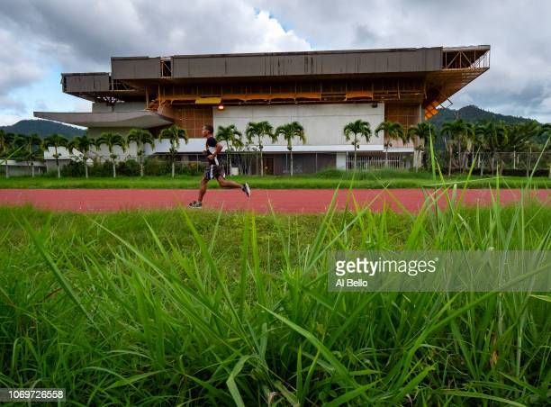 Juan Hernandez Gonzalez who is a student at the Cayay campus of the University of Puerto Rico runs on the University's athletics track that that had...
