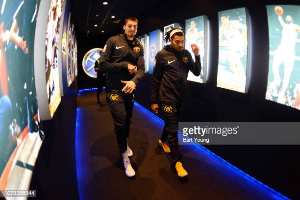 Juan Hernangomez and DeVaughn AkoonPurcell of the Denver Nuggets arrive before the game against the Oklahoma City Thunder on December 14 2018 at the...