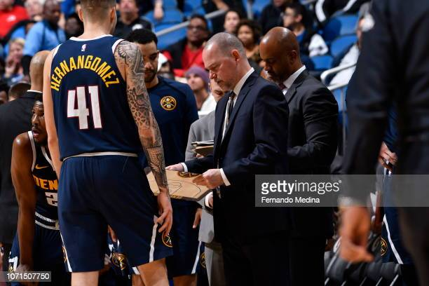 Juan Hernangomez and Michael Malone of the Denver Nuggets draw up a play against Orlando Magic on December 5 2018 at Amway Center in Orlando Florida...