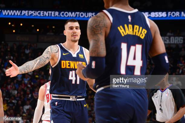 Juan Hernangomez hifives Gary Harris of the Denver Nuggets January 17 2019 at the Pepsi Center in Denver Colorado NOTE TO USER User expressly...